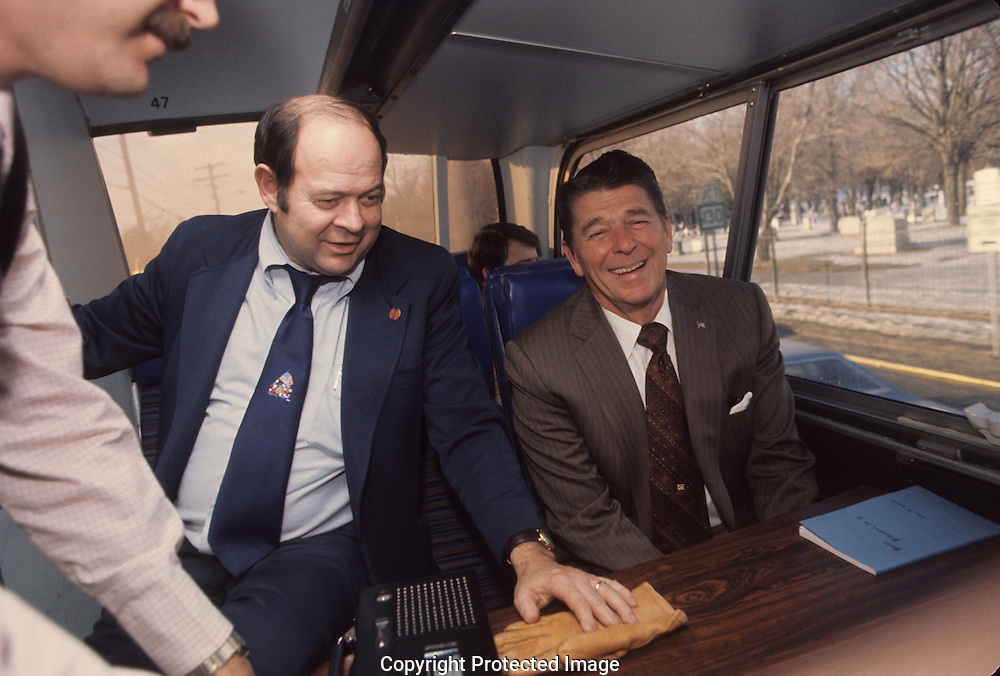 Lyn Nofziger manages a radio interview on the campaign bus during the Reagan campaign fro president in 1980..Photograph by Dennis Brack bb 34