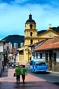 Bell tower of the Iglesia de La Candeleria towers over the historic neighborhood of La Candeleria in Bogota, Colombia.