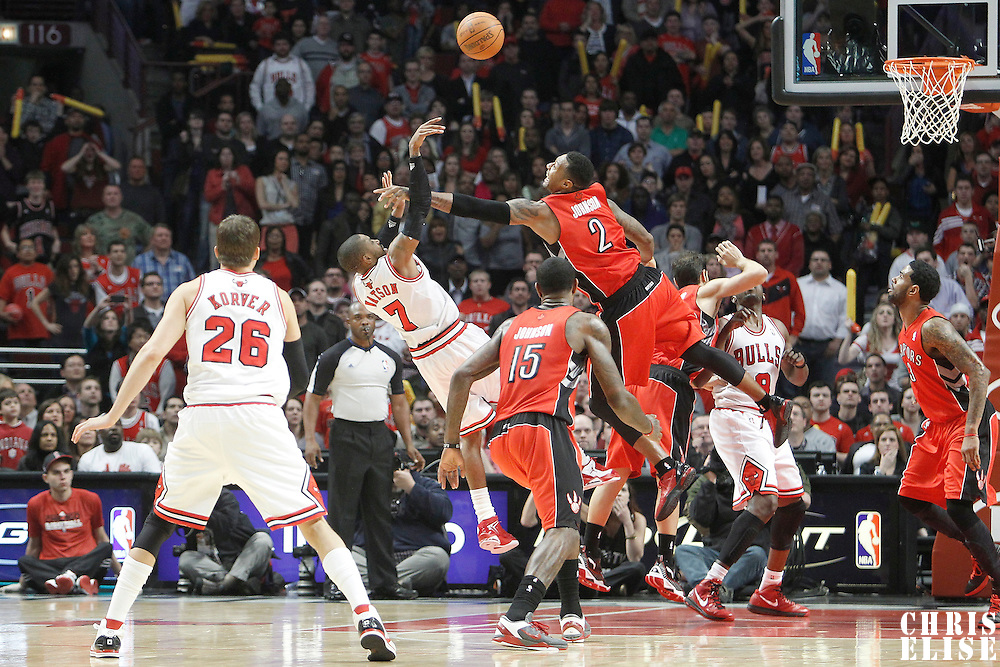 24 March 2012: Chicago Bulls point guard C.J. Watson (7) takes the last shot of the overtime during the Chicago Bulls 102-101 victory in overtime over the Toronto Raptors at the United Center, Chicago, Illinois, USA.