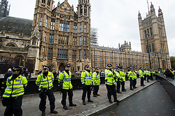 © Licensed to London News Pictures. 04/11/2015. London, UK.  Police guard parliament as Thousands of students take part in a demonstration in central London against tuition fees. The rally which starts outside the University of London Union, will feature a speech from Shadow Chancellor John McDonnell.  Photo credit: Ben Cawthra/LNP