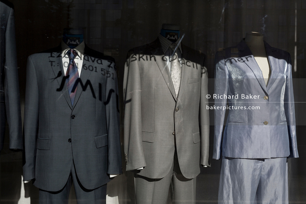 Shiny suits on display in a clothes shop window on Dunajska Cesta (street) in the Slovenian capital, Ljubljana, on 27th June 2018, in Ljubljana, Slovenia.