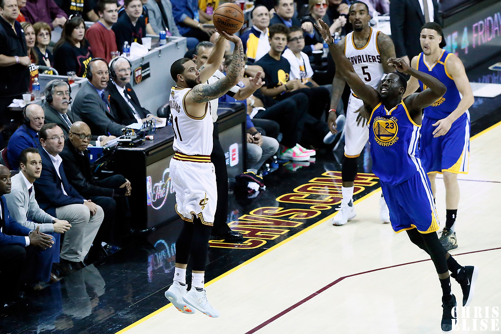 07 June 2017: Cleveland Cavaliers guard Deron Williams (31) takes a jump shot over Golden State Warriors forward Draymond Green (23) during the Golden State Warriors 118-113 victory over the Cleveland Cavaliers, in game 3 of the 2017 NBA Finals, at  the Quicken Loans Arena, Cleveland, Ohio, USA.