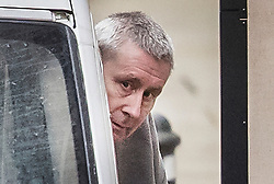 © Licensed to London News Pictures. 07/02/2018. London, UK. JOHN WORBOYS peers round as he exits his prison van as he is escorted in handcuffs into the High Court in London where two of his victims are due to challenge the decision to release him from prison. London Mayor Sadiq Khan will also urge Sir Brian Leveson and Mr Justice Garnham to allow judicial review action against the Parole Board. Photo credit: Peter Macdiarmid/LNP