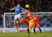 Portsmouth midfielder Michael Doyle beats Leyton Orient Midfielder Sammy Moore to the ball during the Sky Bet League 2 match between Portsmouth and Leyton Orient at Fratton Park, Portsmouth, England on 6 February 2016. Photo by Adam Rivers.