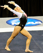 University of Utah senior Jacquelyn Johnson during her floor routine at the 2011 Women's NCAA Gymnastics Semifinals on April 15, in Cleveland, OH. The Utes advanced to tomorrow's super six. (photo/Jason Miller)