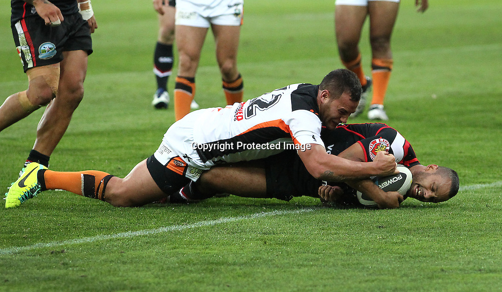 Warriors' Jayson Bukuya dives in to score during the NRL match between The Warriors v Wests Tigers. Westpac Stadium, Wellington. 29 March 2014. Photo.: Grant Down / www.photosport.co.nz