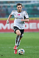 Legia's Bartosz Bereszynski controls the ball during T-Mobile ExtraLeague soccer match between Legia Warsaw and Wisla Krakow in Warsaw, Poland.<br /> <br /> Poland, Warsaw, March 15, 2015<br /> <br /> Picture also available in RAW (NEF) or TIFF format on special request.<br /> <br /> For editorial use only. Any commercial or promotional use requires permission.<br /> <br /> Mandatory credit:<br /> Photo by © Adam Nurkiewicz / Mediasport