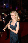 Mena Suvari, Arriving for the Baftas, Leicester Sq. 23  February 2003. © Copyright Photograph by Dafydd Jones 66 Stockwell Park Rd. London SW9 0DA Tel 020 7733 0108 www.dafjones.com
