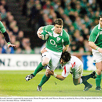 24 February 2007; Brian O'Driscoll, Ireland, supported by team-mates Shane Horgan, left, and Marcus Horan, is tackled by Harry Ellis, England. RBS Six Nations Rugby Championship, Ireland v England, Croke Park, Dublin. Picture Credit: Brendan Moran / SPORTSFILE
