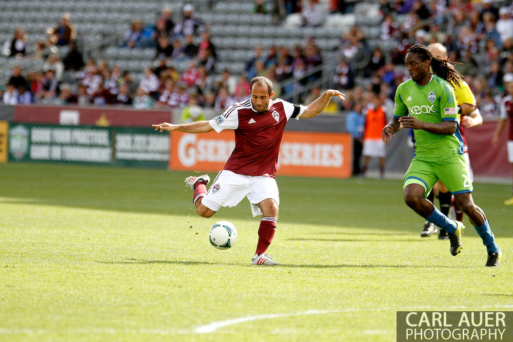 April 20th, 2013 Commerce City, CO - Colorado Rapids midfielder Nick LaBrocca (2) attempts a shot on goal past Seattle Sounders FC defender DeAndre Yedlin (2) in the first half of action of the MLS match between the Seattle Sounders FC and the Colorado Rapids at Dick's Sporting Goods Park in Commerce City, CO