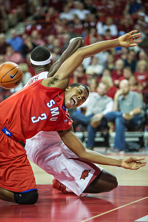 FAYETTEVILLE, AR - NOVEMBER 18:  Sterling Brown #3 of the SMU Mustangs goes after a loose ball with Bobby Portis #10 of the Arkansas Razorbacks at Bud Walton Arena on November 18, 2013 in Fayetteville, Arkansas.  The Razorbacks defeated the Mustangs 89-78.  (Photo by Wesley Hitt/Getty Images) *** Local Caption *** Sterling Brown; Bobby Portis
