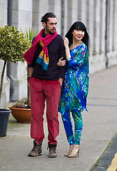 Repro Free:.Model Yomiko (wearing a Hummingbird printed Kimono by Jennifer Rothwell and butterfly necklace by Pluck and Devour) and Karl (wearing a heather knitted sweater and cords both by Magee and multicoloured knit Scarf by Edel MacBride) pictured at Showcase 2013, showcasing the best of fashion from leading Irish designers and homewear this week at Ireland's largest international trade fair. Showcase takes place at the RDS from Sunday 20th to Wednesday 23rd January. For more information visit www.showcase .com. Picture Andres Poveda