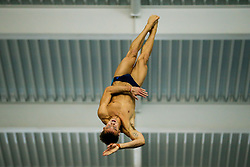 Tom Daley performs his new world first 'Firework' Dive during practice, a forward 3.5 somersaults with one twist in the piked position (5172B) - Photo mandatory by-line: Rogan Thomson/JMP - 07966 386802 - 20/02/2015 - SPORT - DIVING - Plymouth Life Centre, England - Day 1 - British Gas Diving Championships 2015.