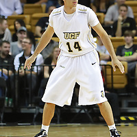 Dogukan Kuzucan (14) of the University of Central Florida Knights mens basketball team plays defense against the West Florida Argonauts in the first home game of the 2010 season at the UCF Arena on November 12, 2010 in Orlando, Florida. UCF won the game 115-61. (AP Photo/Alex Menendez)