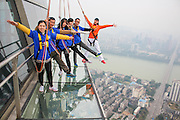 LIUZHOU, CHINA - DECEMBER 27: (CHINA OUT) <br /> <br /> Tourists Experience On 303-meter-high Glass Plank Road<br /> <br /> Tourists walk on a 303-meter-high glass plank road located in the Guangxi\'s highest building - Imperial estate international Fortune Center on December 27, 2015 in Liuzhou, Guangxi Zhuang Autonomous Region of China. The glass plank road is situated on the 76th storey of Imperial estate international Fortune Center which has been the first outdoor glass panoramic deck in Guangxi and the fourth in China. <br /> ©Exclusivepix Media
