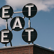 Eat signage on restaurant building for architectural photos