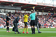Gaston Ramirez (21) of Middlesborough is shown a yellow card by referee Graham Scott during the Premier League match between Bournemouth and Middlesbrough at the Vitality Stadium, Bournemouth, England on 22 April 2017. Photo by Graham Hunt.
