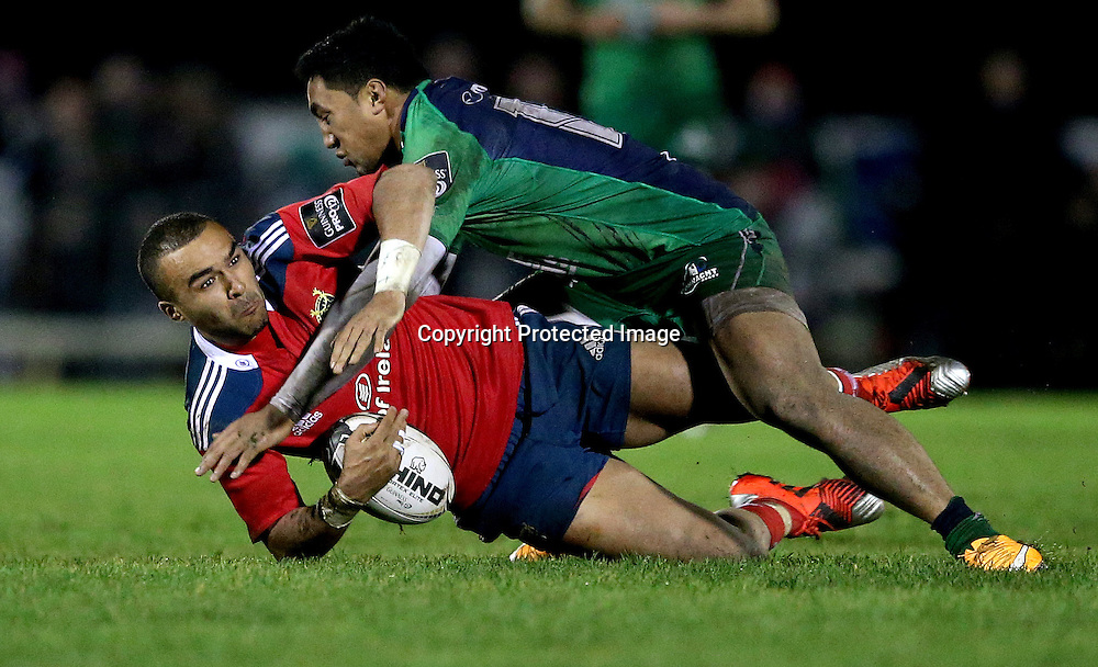 Guinness PRO12, Sportsground, Galway 1/1/2015<br /> Connacht vs Munster<br /> Munster's Simon Zebo and Bundee Aki of Connacht<br /> Mandatory Credit &copy;INPHO/James Crombie