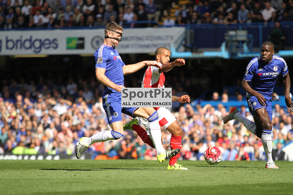 Arsenals Theo Walcott is brought down by Gary Cahill