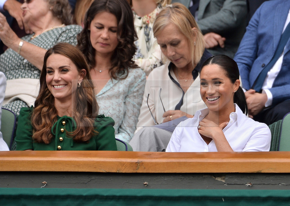 © Licensed to London News Pictures. 13/07/2019. London, UK. HRH The Duchess of Cambridge, HRH The Duchess of Sussex watch the ladies singles finals on centre court tennis on Day 12 of the Wimbledon Tennis Championships 2019 held at the All England Lawn Tennis and Croquet Club. Photo credit: Ray Tang/LNP