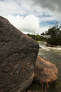 Ancient Petroglyphs (Rock carvings)<br /> Exposed at low river levels these carvings are thought to be at least 10,000 years old.<br /> Fairview Amerindian Village<br /> Iwokrama Forest Reserve<br /> GUYANA<br /> South America