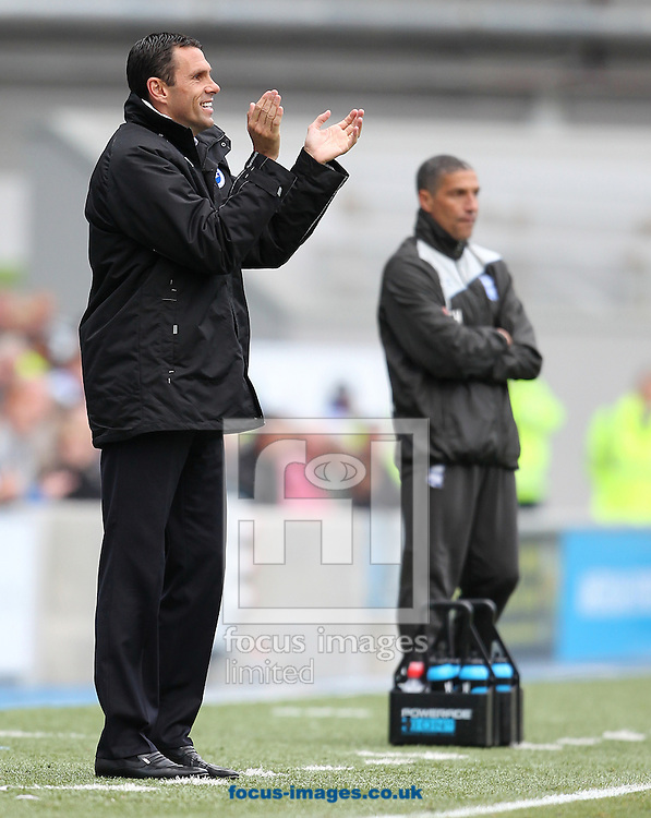 Picture by Paul Terry/Focus Images Ltd. 07545642257.21/04/12.Gus Poyet (L) , manager of Brighton and Hove Albion and Chris Hughton, manager of Birmingham City during the Npower Championship match at The American Express Community Stadium, Brighton