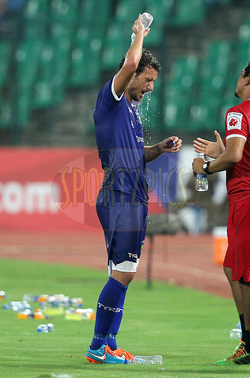 Elano Blumer of Chennaiyin FC pours water to cool himself after winning the match 15 of the Hero Indian Super League between Chennaiyin FC and Mumbai City FC held at the Jawaharlal Nehru Stadium, Chennai, India on the 28th October 2014.<br /> <br /> Photo by:  Vipin Pawar/ ISL/ SPORTZPICS