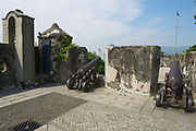 MACAU, CHINA - SEPTEMBER 11, 2013: Old Portuguese cannons located on the exterior wall of the Guia Fortress in Macau, China.