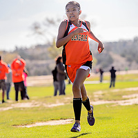 110114       Cable Hoover<br /> <br /> Gallup Bengal Winona Martin sprints in for a first-place finish at the  district cross country meet at the Fox Run Golf Course in Gallup Saturday.