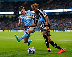 Rolando Aarons of Newcastle United is tackled by James Milner of Manchester City - Photo mandatory by-line: Rogan Thomson/JMP - 07966 386802 - 29/10/2014 - SPORT - FOOTBALL - Manchester, England - Etihad Stadium - Manchester City v Newcastle United - Capital One Cup Fourth Round.
