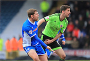 Grant Holt, Chris Basham during the Sky Bet League 1 match between Rochdale and Sheffield Utd at Spotland, Rochdale, England on 27 February 2016. Photo by Daniel Youngs.