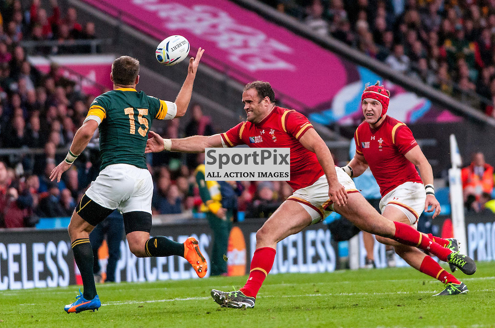 Jamie Roberts of Wales tries to tackle South Africa's Willie le Roux. Action from the South Africa v Wales quarter final game at the 2015 Rugby World Cup at Twickenham in London, 17 October 2015. (c) Paul J Roberts / Sportpix.org.uk