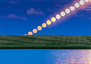 The rising Full Moon of June, dubbed the &ldquo;Strawberry Moon&rdquo; in the media, as seen rising over a prairie pond in southern Alberta, on June 9, 2017. At right, the glitter path from the Moon also combines on the water. <br /> <br /> This illustrates the effect of the Moon brightening and becoming less red/yellow as it rises into clearer air above the horizon, with less atmospheric absorption of the short wavelengths. <br /> <br /> This is a composite stack, obviously, of 15 exposures, selected to be about 2.5 minutes apart, from a time-lapse sequence of 1100 frames, with images taken at two second intervals. Shot with the Canon 6D and 200mm lens.