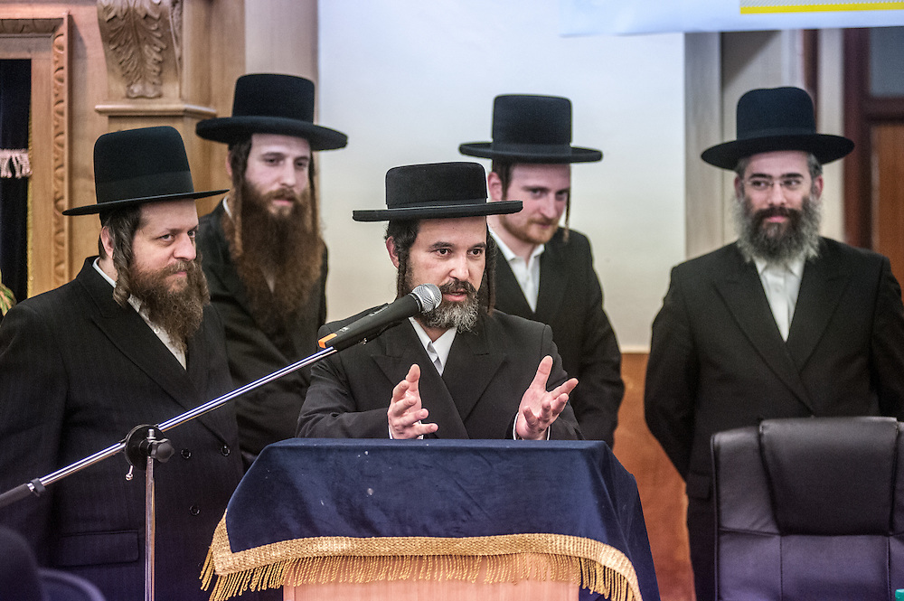London, UK - 3 December 2014: a member of the community speaks as Mr Stephen Williams MP, Parliamentary Under Secretary of State for Communities and Local Government, visits Talmud-Torah Yetev-Lev orthodox Jewish school in Hackney, London
