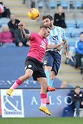 Coventry City midfielder Romain Vincelot beats Peterborough United midfielder Jon Taylor to a header during the Sky Bet League 1 match between Coventry City and Peterborough United at the Ricoh Arena, Coventry, England on 31 October 2015. Photo by Alan Franklin.