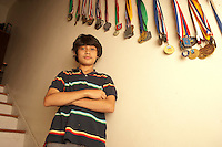 Portrait of teenage boy standing with arms crossed