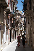 Street scene in ornate alleyway Via Dione in Ortigia, Syracuse, Sicily