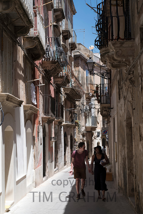 Street scene in ornate alleyway Via Dione in Ortigia, Syracuse, Sicily