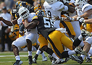 September 21 2013: Western Michigan Broncos running back Dareyon Chance (22) is hit by Iowa Hawkeyes linebacker Marcus Collins (55) during the second quarter of the NCAA football game between the Western Michigan Broncos and the Iowa Hawkeyes at Kinnick Stadium in Iowa City, Iowa on September 21, 2013. Iowa defeated Western Michigan 59-3.