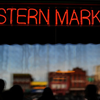 Eastern Market neon sign with village building reflections at Russell St. Deli in Detroit, Michigan