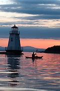 Kayaking on Lake Champlain at sunset in Burlington, Vermont.