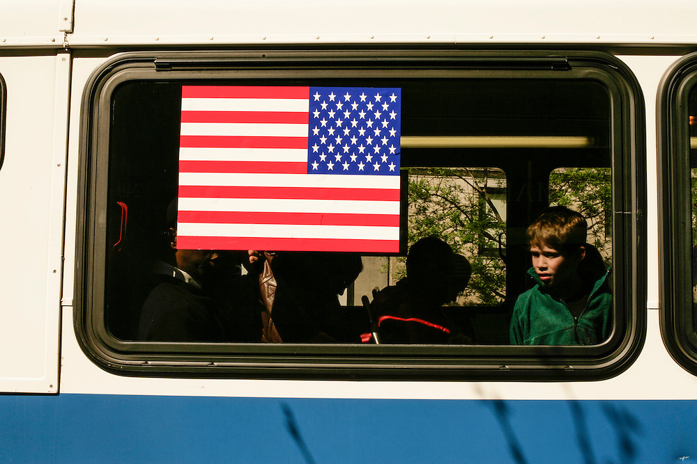 A boy looks out of a bus window in Manhattan, New York.