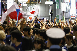 June 29, 2018 - Tokyo, Japan - Japanese soccer fans celebrate in Shibuya after their team advanced to the second round of World Cup in Tokyo, Japan. Japan's Soccer National Team. Japan sealed their position to the second round of the FIFA World Cup despite losing to Poland 1-0 in Volgograd Arena in Volgograd, Russia. Soccer fans who watched the game in Tokyo gathered in Shibuya's famous scramble crossing to celebrate, the Tokyo Metropolitan Police were on hand to control access. (Credit Image: © Rodrigo Reyes Marin/via ZUMA Wire via ZUMA Wire)
