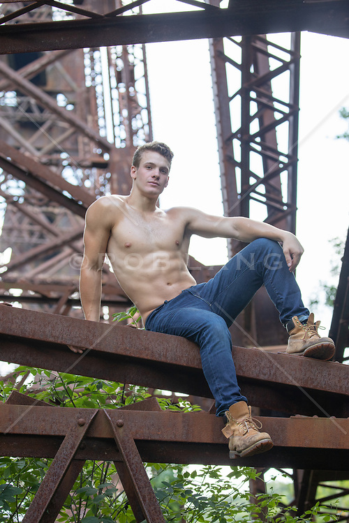 All American shirtless muscular man on a train trestle