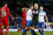 todays referee Mark Brown explains his penalty decision to Swindon Town defender Raphael Rossi Branco (29)  during the EFL Sky Bet League 1 match between Bury and Swindon Town at the JD Stadium, Bury, England on 11 February 2017. Photo by Simon Davies.