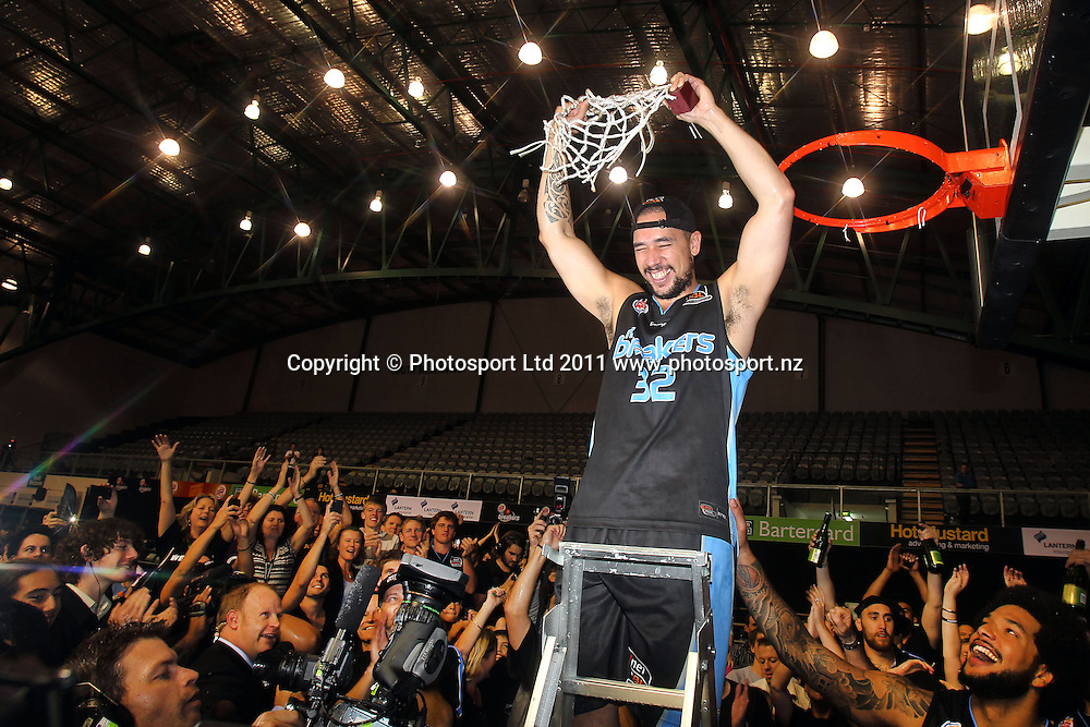 Breakers' Paul Henare cuts the net down. iinet ANBL, Grand Final Game 3, New Zealand Breakers vs Cairns Taipans, North Shore Events Centre, Auckland, New Zealand. Friday 29th April 2011. Photo: Anthony Au-Yeung / photosport.co.nz