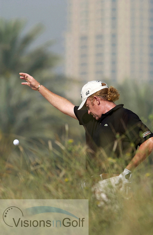 Miguel Angel Jimenez drops his ball <br />