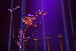 "© Licensed to London News Pictures. 15/05/2013. London, England. Picture: Danik Abishev performs a hand balancing act on high poles. Creators of the critically-acclaimed ""Cantina"" return to London this summer (10 May to 29 September) with their new show ""Limbo"" at London Wonderground/Southbank Centre. London Wonderground headline act ""Limbo"" is a mix of cabaret, circus and acrobatics.  Photo credit: Bettina Strenske/LNP"