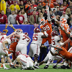Jan 1, 2018; New Orleans, LA, USA; Alabama Crimson Tide place kicker Andy Pappanastos (12) attempts a field goal during the second quarter against the Clemson Tigers in the 2018 Sugar Bowl college football playoff semifinal game at Mercedes-Benz Superdome. Mandatory Credit: Derick E. Hingle-USA TODAY Sports