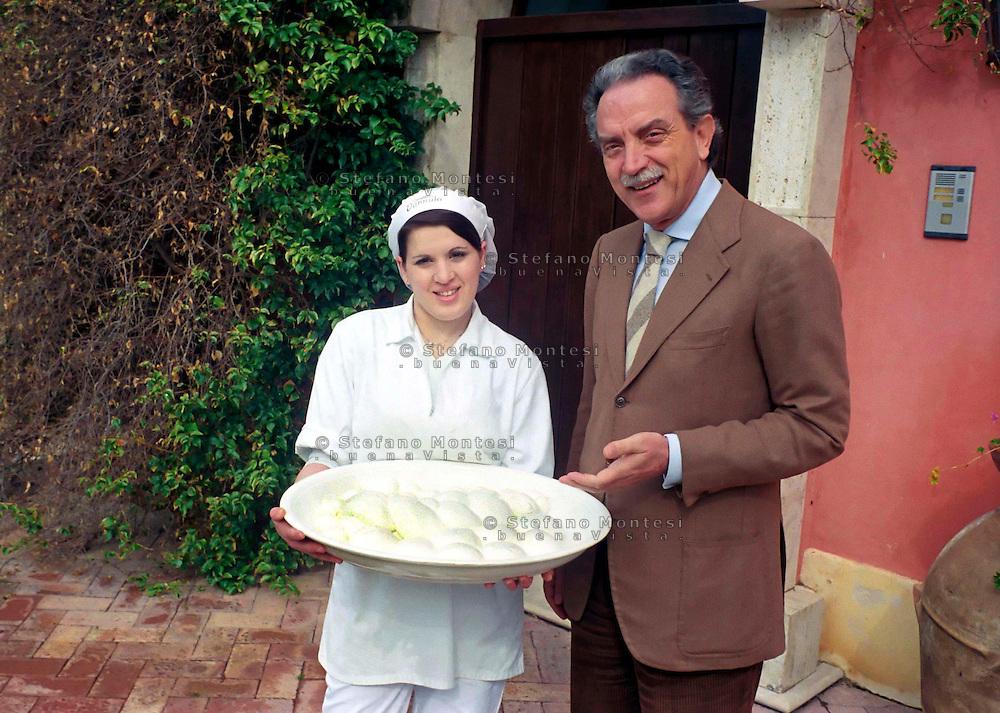 The Vannulo cheese factory in Campania...Tenuta Vannulo..Azienda   Agricola Biologica Antonio Palmieri..Caseificio Vannulo..Dott.Antonio Palmieri an employee with the mozzarella of bufala ..http://www.vannulo.it/production.html........